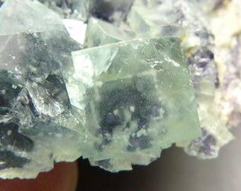 Green cubic fluorite with black fibrous boulangerite inclusion core and dolomite (?) inclusion from Inner Mongolia China B1886