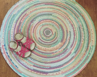 Fabric wrapped coiled rope rug