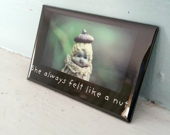 "Refrigerator Magnet Adventures of Claudia Porcelain Doll ""She Always Felt Like A Nut"" Typographic Magnet"