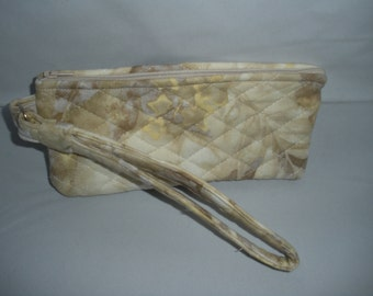 Beige and cream colored wristlet