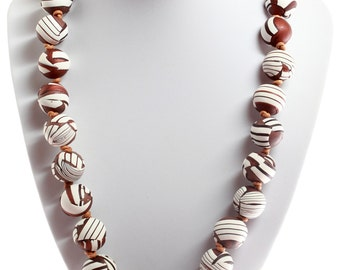 Polymer clay bead necklace on leather cord.