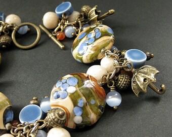 Umbrella Charm Bracelet. Lampwork Glass and Gemstone Bracelet in Blue, Tan and Bronze - Rain in the Desert. Handmade Bracelet.