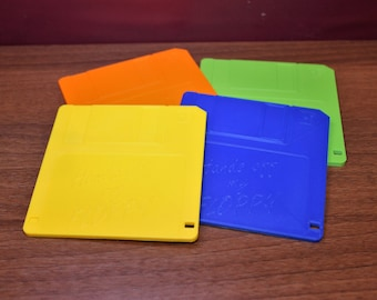 Floppy disc coaster 3D printed in a range of colours and with customisable text. A retro blast from the past.