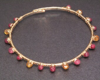 Hammered heavy gauge bangle with peridot, ruby, and mandarin garnet beads Bracelet 40