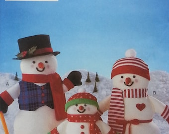 """Snowman Family Pattern by Butterick 4120 Snowman Family includes 16"""" inch and 11"""" inch Snowman with hat,hat band, scarf,cuffs, and mittens."""