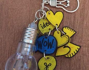 Idea lightbulb necklace with shrink art charms
