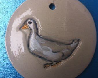 Disc decorative goose hanging in white stoneware