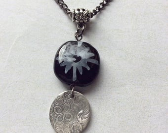 Kazuri black and white mezzo with imprinted fine silver pendant necklace.