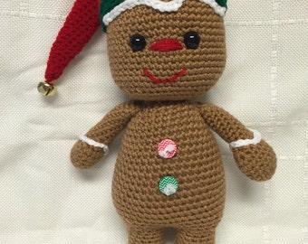 Crocheted gingerbread snuggle buddy.