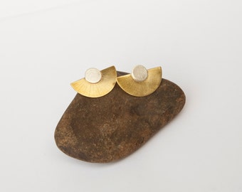 Very stylish earrings in brass and silver, in a half moon shape with fine engravings.