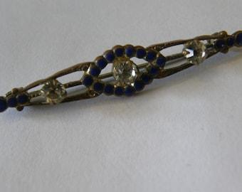 Vintage 1920's brass, enamel and rhinestone brooch