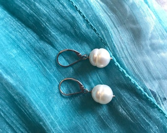 Fresh water pearl earrings .