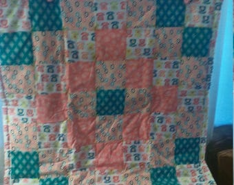 Old fashioned telephones on a soft flannel and cotton baby quilt