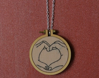 Embroidered necklace of heart made by hands