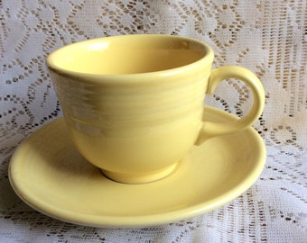 Vintage Fiesta Homer Laughlin yellow cup and saucer.