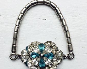 1920s ART DECO BRACELET featuring aqua blue and clear crystal rhinestones in silver tone setting with a stretch bracelet