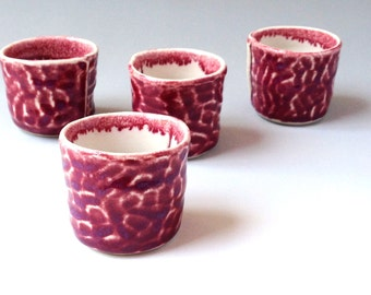 Red and white stoneware ceramic shot cup