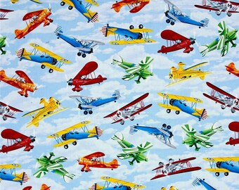 Propeller Airplanes on Sky Blue from Timeless Treasures