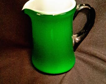Hall-like small green pitcher