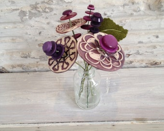 purple burgundy button flower bottle bouquet
