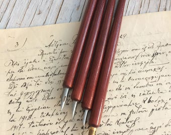 Wooden handle dip pens with nib, unused vintage stock. Listing is for one dip pen.