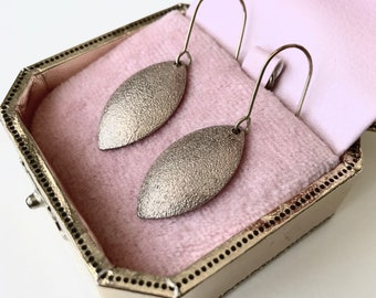 Textured gold drop earrings created from a vintage necklace