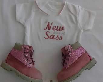 A new kind of SASS baby vest.