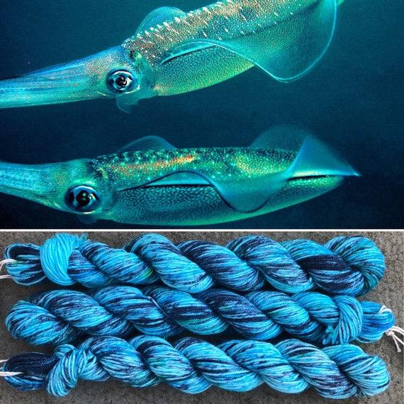 Bigfin Reef Squid 20g Miniskein, blue green speckled merino nylon sock yarn