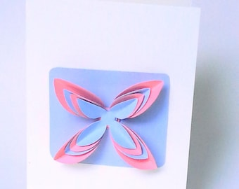 The card and its geometric pink/purple flower with envelope