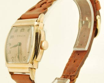 Gruen vintage wrist watch, 15 Jewels, rose gold filled and stainless steel rectangular case with flared sides and stepped frame detail