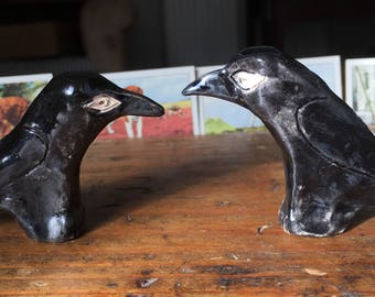 Pair of handmade ceramic crows