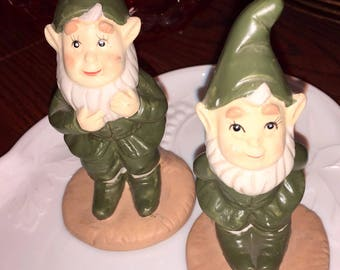 A pair of vintage gnomes wearing green