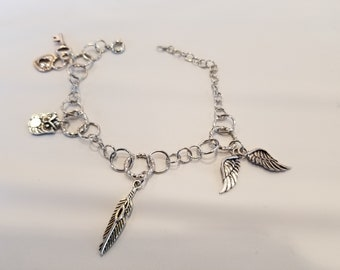 Charm Bracelet: wings, feather, owl, lock and key