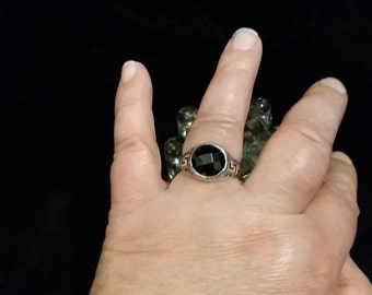 R 919 Sterling silver ring with a multifaceted stone. Approximate size is a 10.5
