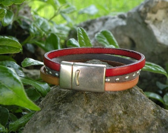 nude leather and Red bracelet