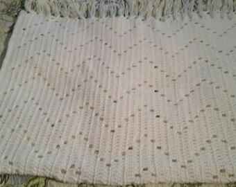 White baby blanket with fringe, zig zag pattern