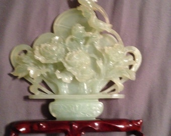 Jade carving on a wooden stand