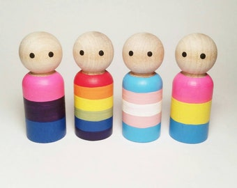 ONE of pictured LGBTQ Pride Peg Doll