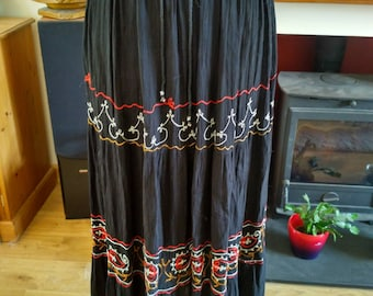 Long black skirt with embroidery