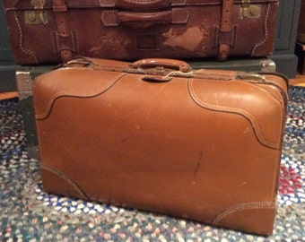 Vintage 1945 brown leather suitcase or luggage
