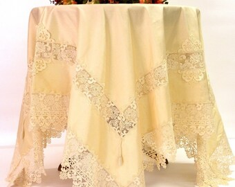 Incredibly beautiful and rich silk and lace ecru luxurious tablecloth.