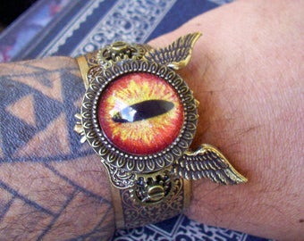 Dragon Eye Cuff (C705-2), Hand Painted Glass Eye, Winged Brass Bracelet and Framework, Gears, Aviation, Industrial,  Orange Gold Sparkle