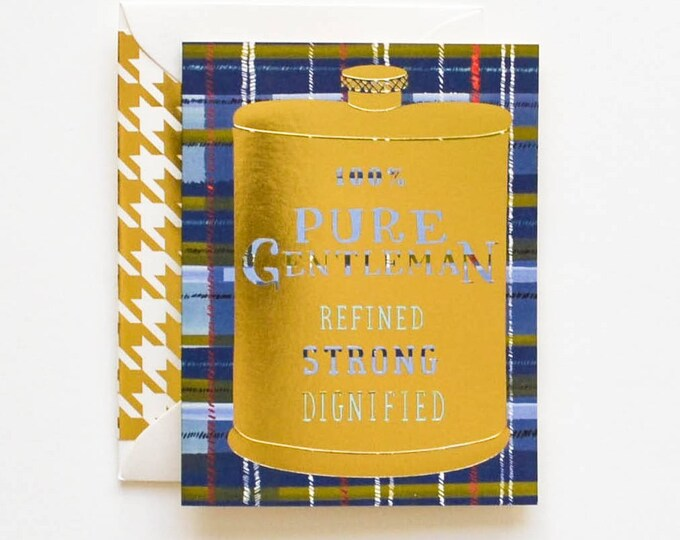 100% Pure Gentleman Gold Flask on plaid