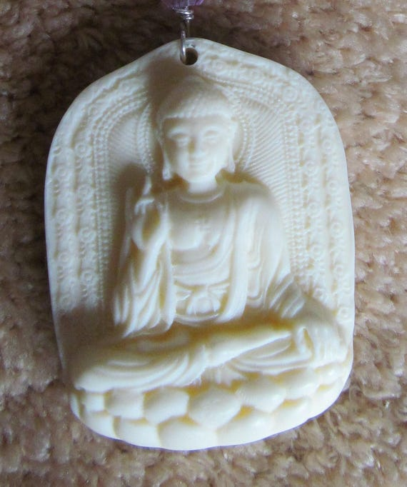 Striking ivory colored shell carved lord buddha pendant mozeypictures Images