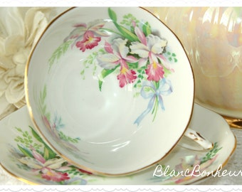 Roslyn, England: ''Sweet Romance'' tea cup and saucer with orchids and blue bow