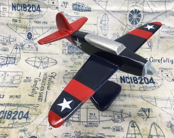 Handcrafted wooden Curtiss Helldiver toy plane