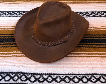 Vintage leather Minnetonka cowboy hat with braided band