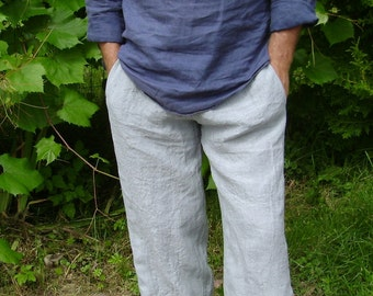 Mens linen trousers/pants/ with side pockets, belt - back with rubber, front smooth with a drawn twine.From washed linen fabric.