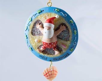 Santa Making A Sand Angel Mele Kalikimaka Christmas Ornament