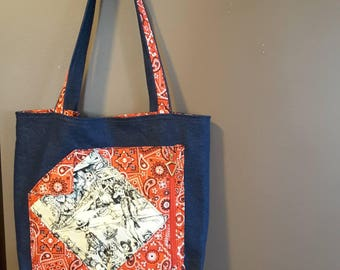 Denim tote with saloon skeletons red paisly.